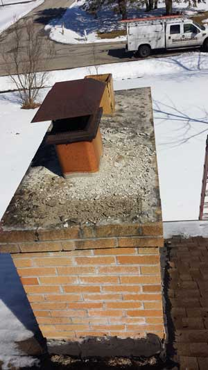 Example of a bad, leaking chimney cap