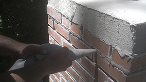 Repointing a defective mortar joint helps solve leaking